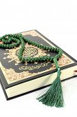 stock photo of quran  - Quran with rosary before a light background - JPG