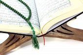 foto of quran  - stand with Quran and rosary before light background - JPG