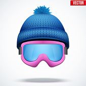 stock photo of knitted cap  - Knitted woolen blue cap with snow ski goggles - JPG