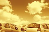 picture of polution  - Closeup view of parked cars with cloudy sky  - JPG
