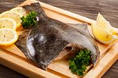 pic of flounder  - Fresh raw flounder on cutting board - JPG
