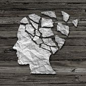 image of medical  - Alzheimer patient medical mental health care concept as a sheet of torn crumpled white paper shaped as a side profile of a human face on an old grungy wood background as a symbol for neurology and dementia issues or memory loss - JPG