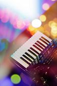 stock photo of accordion  - Accordion with color bokeh light in background - JPG