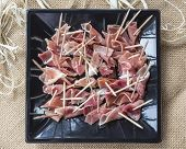 picture of charcuterie  - slices of ham with toothpicks on a serving dish - JPG