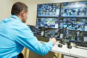 image of supervision  - security guard watching video monitoring surveillance security system - JPG