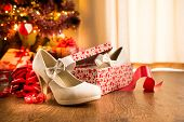 stock photo of shoe-box  - White female elegant shoes in a gift box with christmas tree and presents on background - JPG