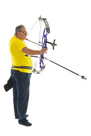 pic of longbow  - Man with yellow shirt and jeans shooting with a longbow isolated in white - JPG