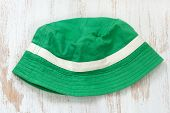picture of panama hat  - green hat on the white wooden background - JPG