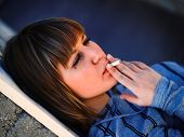 stock photo of teen smoking  - Young student smoking in front of her school - JPG