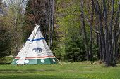 foto of wigwams  - Traditional Native American tepee in upper Midwest USA State Park - JPG