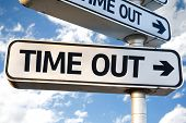 stock photo of time flies  - Time Out direction sign on sky background - JPG