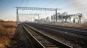 stock photo of railroad yard  - Railroad tracks stretching into the distance beyond the horizon - JPG