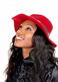 image of woman red blouse  - A lovely African American woman in a black blouse and long black curly