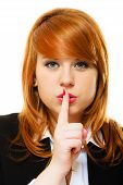 stock photo of hush  - Business woman redhaired girl asking for silence or secrecy with finger on lips hush hand gesture - JPG