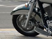 pic of amortization  - Motorcycle wheel on a background of road asphalt - JPG
