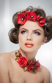picture of red-necked  - Portrait of beautiful girl in studio with red flowers in her hair and red roses around her neck - JPG