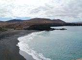 picture of atlantic ocean beach  - The black beach of Puerto de la Pena in the Ajuy nature park on the island Fuerteventura one of the Canary islands in the Atlantic ocean belonging to Spain - JPG