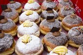 stock photo of donut  - Various Warm and sweet donuts in a market bakery - JPG