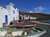 pic of negro  - The bay and the white houses of the fishing village Pozo Negro at the Atlantic ocean on the Island Fuerteventura belonging to Spain - JPG