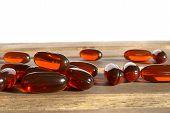 pic of prophylactic  - few dietary supplement pills on wooden desk - JPG