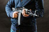 pic of terrorist  - terrorist holding rifle on a black background - JPG