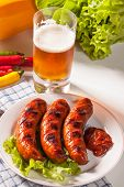 foto of grilled sausage  - Grilled sausage on a plate - JPG