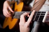 stock photo of acoustic guitar  - Close up image of woman playing acoustic guitar  - JPG