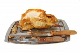 picture of carving  - Part carved Guinea fowl on a carving dish with carving knife and fork isolated against white - JPG