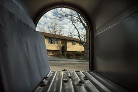 picture of mailbox  - Mail sitting inside an open mailbox with a house visible over the street - JPG