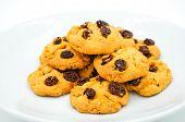 stock photo of baked raisin cookies  - Raisin and cornflake cookies on white background - JPG