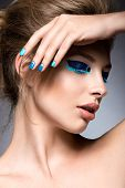 stock photo of nail-design  - Beautiful girl with bright creative fashion makeup and blue nail polish - JPG