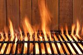 stock photo of braai  - Flaming BBQ Charcoal Cast Iron Grill Close - JPG