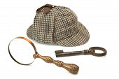 stock photo of sherlock  - Sherlock Holmes Deerstalker Cap Vintage Magnifying Glass And Old Key Isolated On White Background - JPG