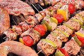 stock photo of braai  - Assorted Roasted Meat with Vegetable On The Hot Barbecue Charcoal Grill - JPG