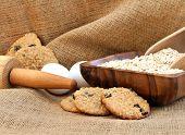 stock photo of baked raisin cookies  - Freshly baked oatmeal raisin cookies on burlap - JPG