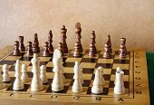 stock photo of chessboard  - One chess king dominating another on the chessboard - JPG