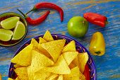 image of nachos  - Mexican food nachos with guacamole chili peppers and  lemon - JPG