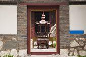 image of buddhist  - A buddhist prayer urn and incense burner at Penglai Fortress Penglai China - JPG