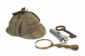 stock photo of investigation  - Sherlock Holmes Deerstalker Cap Vintage Magnifying Glass Retro Flashlight And Old Rusty Key Isolated On White Background - JPG
