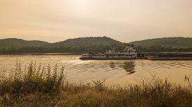 pic of coal barge  - Coal Barge on a River - JPG