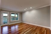 Empty Room With Hardwood Floor And Door To Balcony. poster