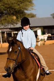 foto of horse-riders  - Small girl riding the horse people diversity series - JPG