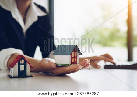 Woman Holds A House Model