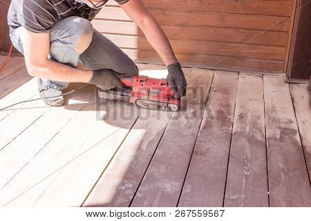 poster of Sanding Hardwood Floor With The Grinding Machine. Repair In The Apartment, Country House, Patio. Car