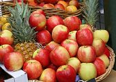 Fresh Apples And Pineapples At The Borough Market In London City United Kingdom poster
