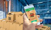Hand Holding Smart Phone Scanning Package Qr Code At The Warehouse, Smart Logistic, Industry 4.0, Sm poster