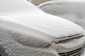Cars Are Covered With Snow After Night Of Snowfall. Snow Storm Covered Cars With Thick Layer Of Snow poster