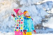 Kids Winter Snow Ball Fight. Children Play In Snow poster