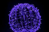 Glowing Blue Garland In The Shape Of A Ball. Christmas Night Blue Light For Holiday. Electric Garlan poster