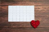 Cardiogram Chart With Small Red Heart On Wood Background. Medical Concept. poster